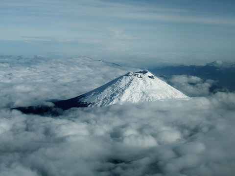 The peak of the Cotopaxi volcano standing above the clouds in the Ecuadorean Andes