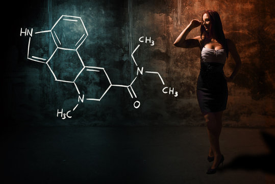 Sexy girl or secretary or female student presenting handdrawn chemical formula of LSD