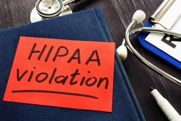 Hipaa violation inscription on a piece of paper.