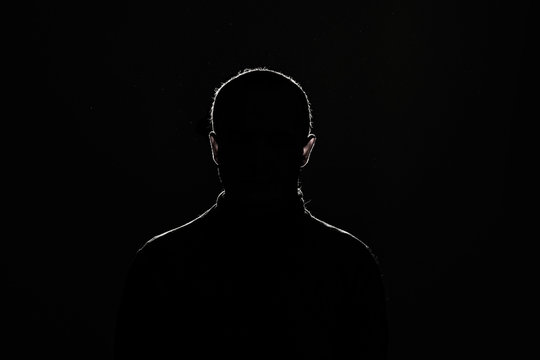 silhouette: guy on black background