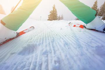 Low angle image of skiing boy over fresh sky slope
