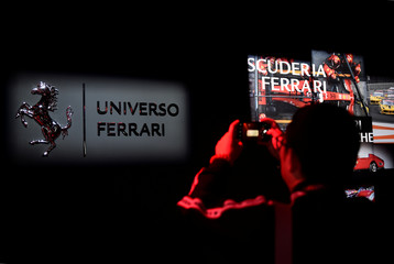 A visitor takes photos during the 'Universo Ferrari' exhibition, in Maranello
