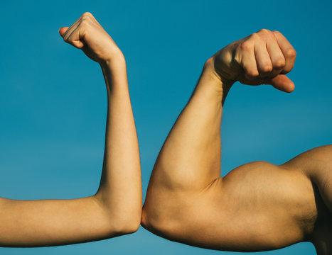 Competition, strength comparison. Vs. Fight hard. Health concept. Hand, man arm, fist. Musclar arm vs weak hand.