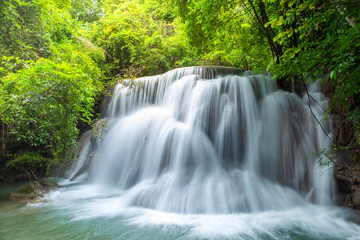 Deurstickers Watervallen Wonderful tiers of waterfall motion in deep jungle, Located Erawan waterfall Kanchanaburi province, Thailand