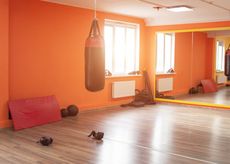New martial arts gym, punching bag, sunlight shining through the window, indoors
