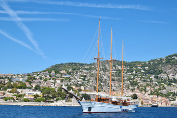 Yahch sealing near port of Villefranche sur Mer, Provence, France. Yacht on the sea with beautiful scenic view
