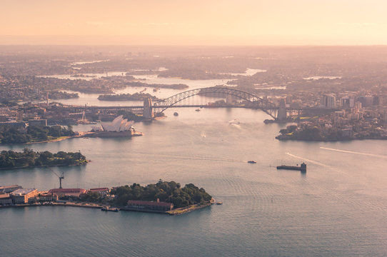 Aerial view of Sydney Harbour with Bridge and waterfront historic suburbs