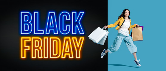 Wall Mural - Black friday advertisement with cheerful shopping girl