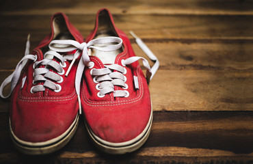 Old red canvas shoes that have been used