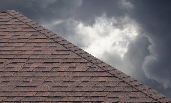 brown roof shingle on cloudy day in rainy season.