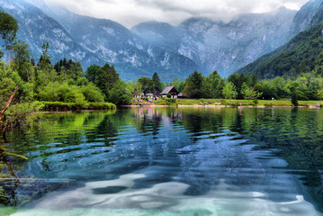 Panoramic view of Lake Bohinj, the largest permanent lake in Slovenia. It is located within the Bohinj Valley of the Julian Alps
