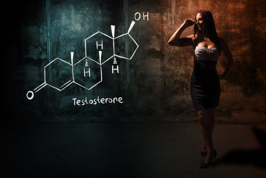 Sexy girl or secretary or female student presenting handdrawn chemical formula of testosterone