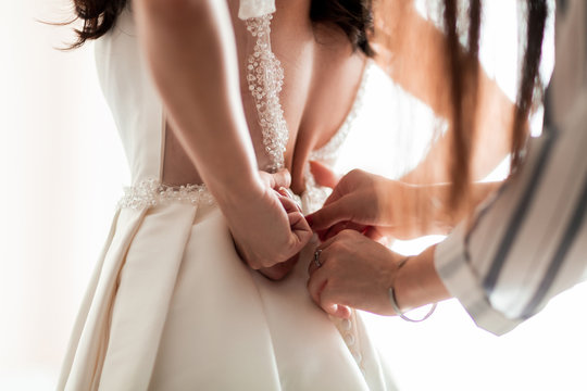 close up. background image of a woman trying on a wedding dress.