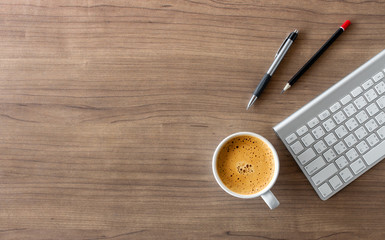 business concept. top view of office desk workspace with smartphone, pen, keyboard, glasses and hot coffee cup on white table background