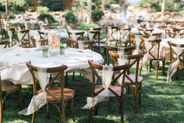Chairs and table at outdoor summer wedding, wedding reception decor, ceremony