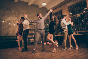Full length photo of cheerful lover dance have christmas time x-mas party in house with newyear...