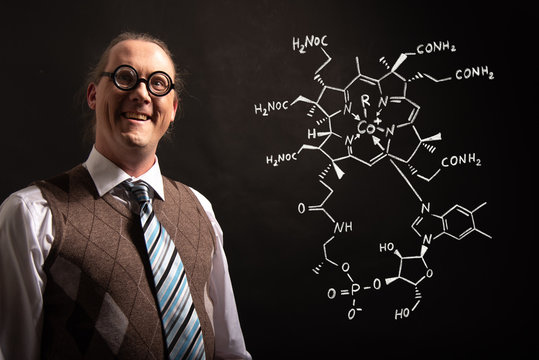Professor presenting handdrawn chemical formula of Vitamin B12
