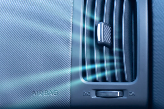 Car air conditioner with illustration of cold air flow from it. Front view close up