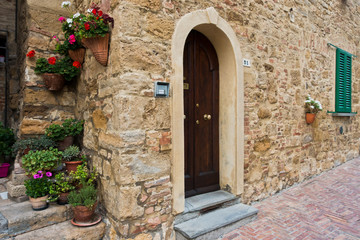Architectural details of old houses at narrow winding streets of Volterra, Tuscany, Italy