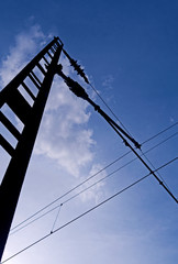 Transportation / Railway: Older catenary mast at an electrified railroad track in Central Germany