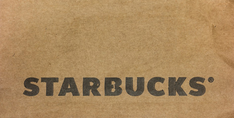 AACHEN, GERMANY OCTOBER, 2017: Starbucks Logo on a paper bag. Starbucks is the largest coffeehouse company in the world, with 20,891 stores in 62 countries.