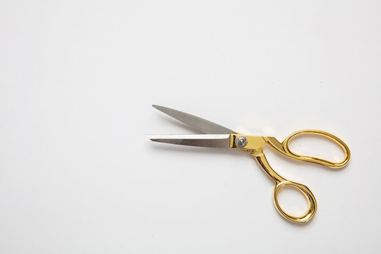 Scissors gold and silver isolated against white background