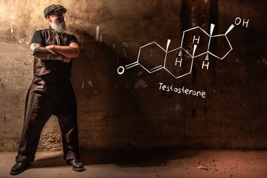 Bearded old man presenting handdrawn chemical formula of testosterone
