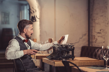 Young man with a retro typewriter