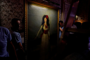 "Workers carry ""XIII Duchess of Alba"" painting by the Spanish painter Francisco Goya at Liria Palace in Madrid"