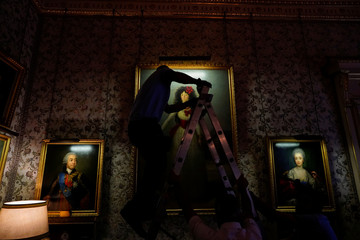 "Workers set ""XIII Duchess of Alba"" painting by the Spanish painter Francisco Goya at Liria Palace in Madrid"