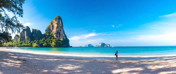 Woman running on amazing Railay beach in Krabi Thailand. Tropical resort.