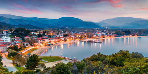 Foto op Canvas Turkije Picturesque spring scene of Aegean sea. Dramatic sunset of Olimpiada town, Greece, Europe. Traveling concept background. Active tourism concept background.