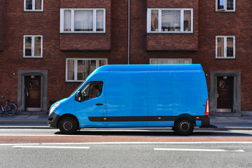 blue commercial truck delivers goods to home