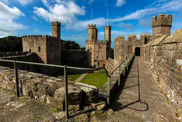 Caernarfon castle. And battlements along the River Seiont in North Wales, United Kingdom