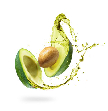 Sliced avocado with splashes isolated on white background