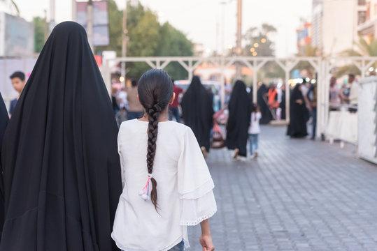 Baghdad, Iraq – July 6, 2019: Iraq family on street