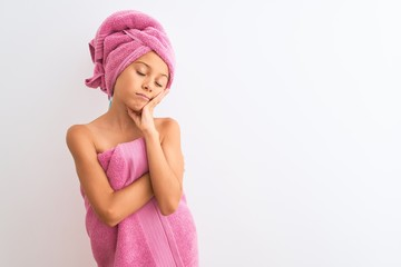 Beautiful child girl wearing shower towel after bath standing over isolated white background thinking looking tired and bored with depression problems with crossed arms.