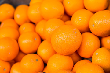 Healthy organic oranges. Top view of ripe tangerines background. Fresh mandarin texture