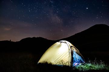 Spoed Foto op Canvas Kamperen Camping in tent under Milky Way in Durmitor, Montenegro, Europe