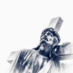 Holy cross with crucified Jesus Christ. Ancient statue. Retro styled image.