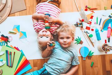 Kids draw and make crafts. Kindergarten or preschool background.