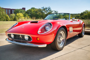 Front side view of a red 1962 Ferrari 250 GT California Spyder classic car on October 18, 2014 in Westlake, Texas.