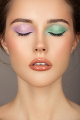 Wall Mural - Fashion portrait of young woman. Colorful eye shadows. Perfect skin.