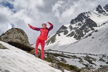 Portrait of tourist in red at the beautiful mountains background.