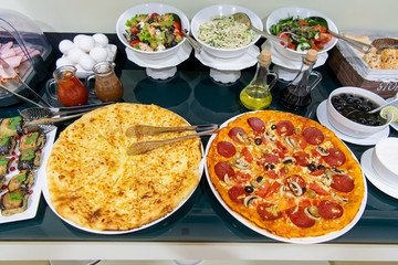 Food and Buffet Decoration with pizza and lots of dishes in a hotel