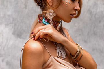 close up of beautiful young woman with lots of boho accessories