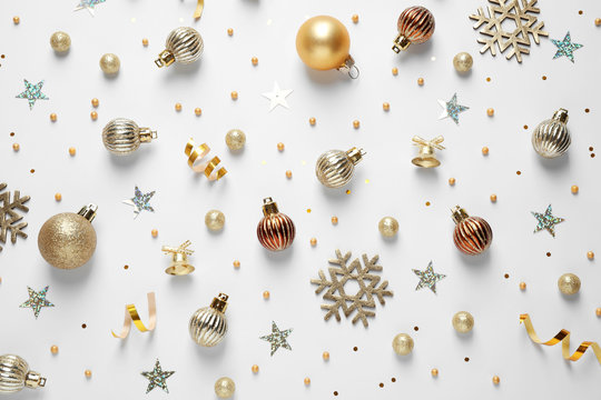 Flat lay composition with Christmas decorations on white background