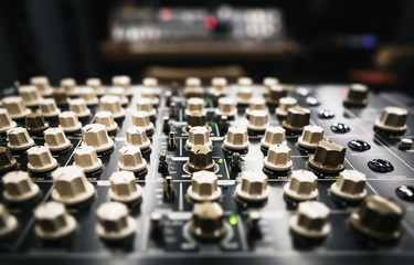 Retro synth panel in sound recording studio.Professional audio equipment for electronic music production.Compose and record new musical tracks in high quality with vintage synthesizer device