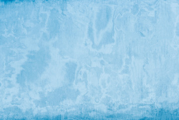 Abstract background from blue color painted on old concrete wall. Retro and vintage wallpaper backdrop.