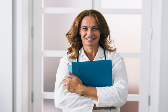 mature woman home doctor. nursing at home concept